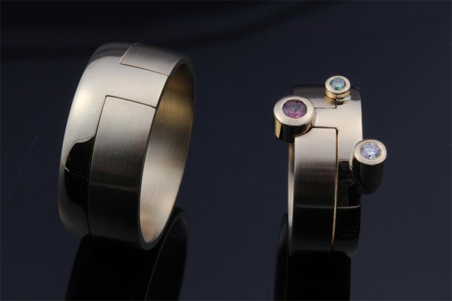 Guldring med färgadde diamanter - Erik Tidäng