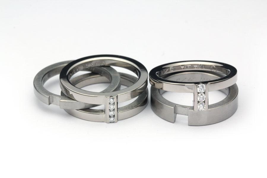 Kombination av vigselringar och förlovningsringar, titan,vitguld och stenar- Erik Tidäng